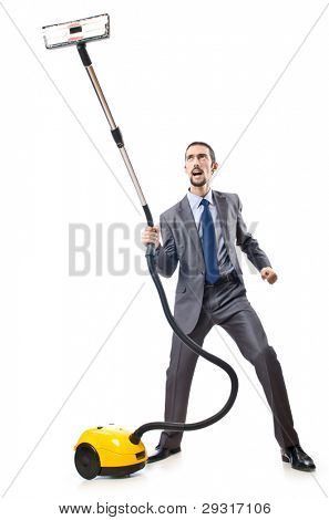 Vacuum cleaning by businessman on white
