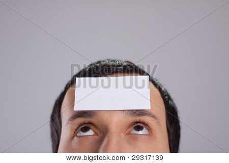 visiting card on forehead