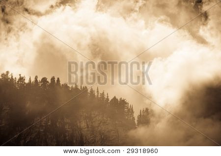 Mountain peak shrouded in clouds