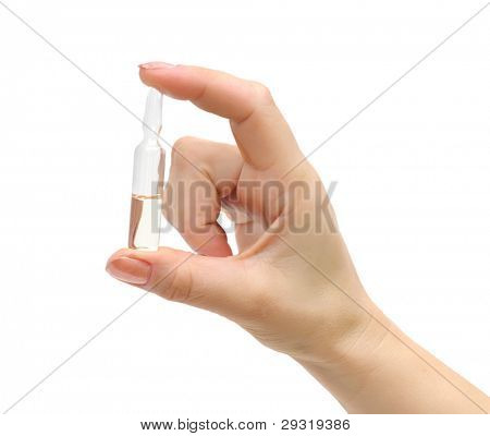 ampoule in a hand isolated on white background