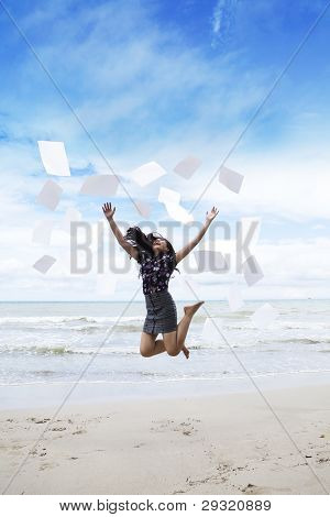 Business Woman Jumping With Paperwork