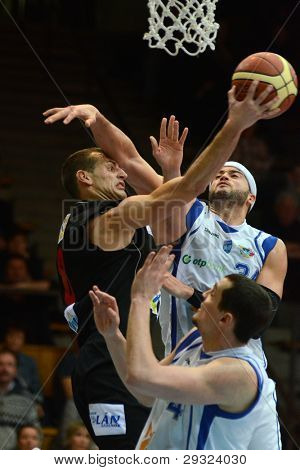KAPOSVAR, HUNGARY - JANUARY 21: Michael Fey (white 34) in action at Hungarian National Championship basketball game with Kaposvar (white) vs. Szolnok (black) on January 21, 2012 in Kaposvar, Hungary.