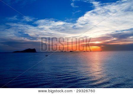 Ibiza cala Conta Conmte sunset with bledas and esparto islands