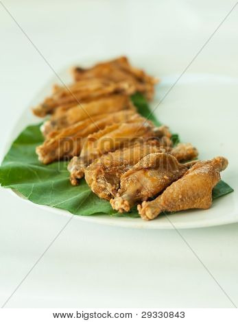 Chicken Wings Fried On White Dish