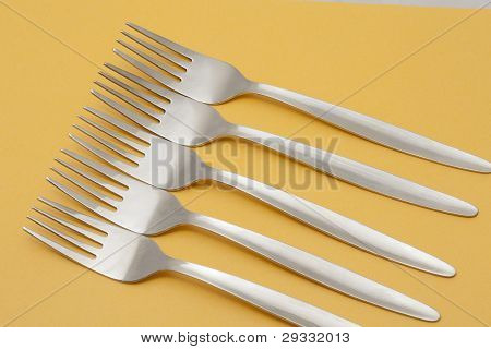 Five Forks Arranged On A Yellow Background