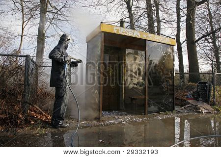 removing graffiti from bus stop