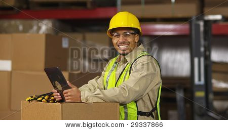Portrait of worker with digital tablet in warehouse