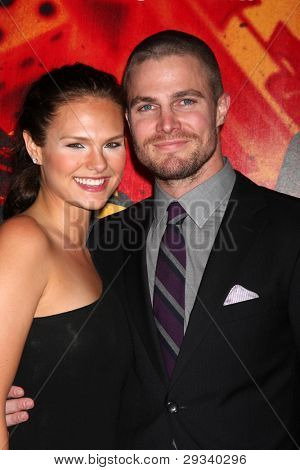 LOS ANGELES - JAN 25:  Cassandra Jean, Stephen Amell arrives at  the