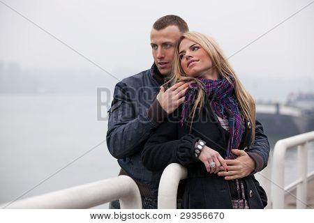 Romantic Outdoor Portrait Of Young Couple