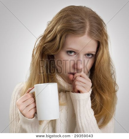 Girl Sick With The Flu Coughs, A Mug Of Tea