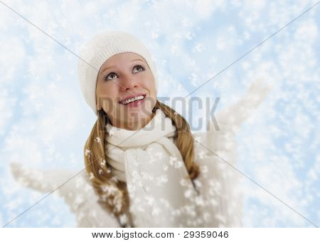Beautiful Happy Girl With Snowflakes On A Winter Background