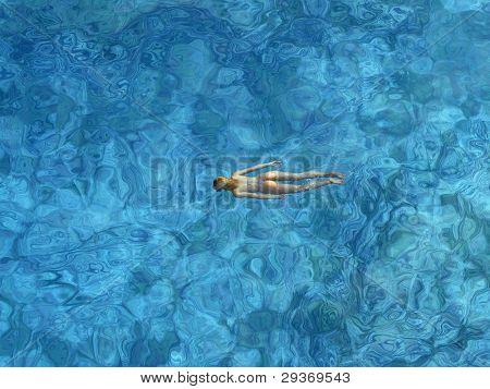 Woman swimming in open sea