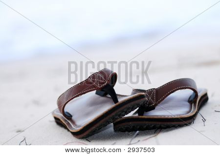 Flipflops On A Sandy Beach