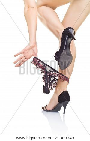 Women's Legs With Panties And Black Shoes