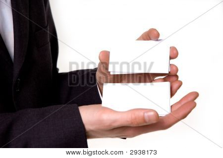 Businessman Holding Blank Business Cards In His Hands