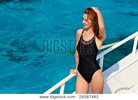 Young Woman In Swimsuit Posing On Yacht