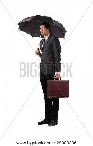 Sad businessman under an umbrella