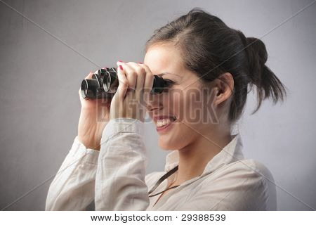 Beautiful woman using binoculars