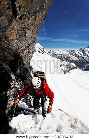 Alpinist climbing Eiger Peak, Switzerland, Europe