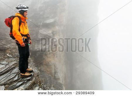 Alpinist contemplating the Eiger Glacier, Switzerland