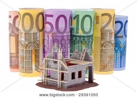 many euro bank notes with shell house. against a white background