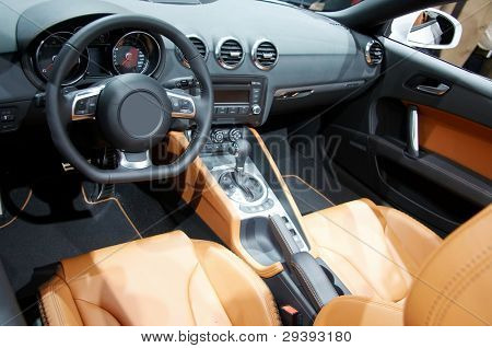 Modern interior of a new car with many details.