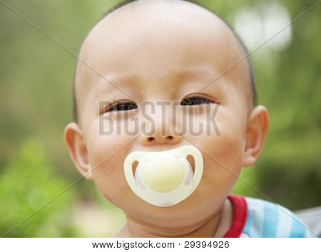 cheerful baby with a pacifier
