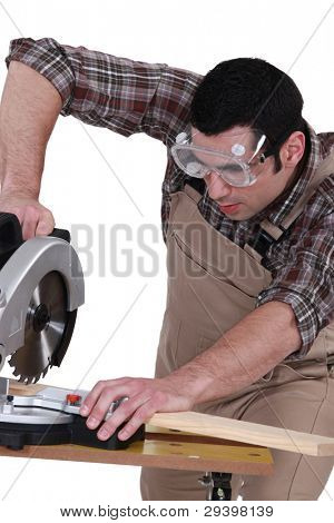 Carpenter with chainsaw
