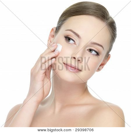 Woman Applying Cream On Face