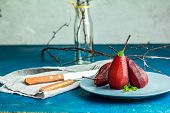 Pears Stewed In Red Wine Or Pomegranate Juice poster
