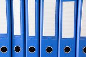 Office Folders Isolated . Row Of Blue Office Folders With Blank Labels On Desk.files And Documents O poster