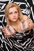 Attractive Blonde Stretches Out Her Hands In Chains