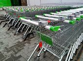 Rows Of Ready To Use Shopping Carts Lined-up In Rows For Storage Near A Supermarket Or Hyper Market poster