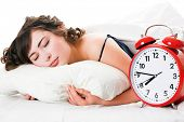 image of underthings  - Portrait of young woman with alarm clock - JPG