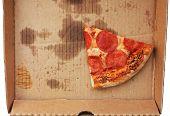 Leftover Pepperoni Pizza Slice In Delivery Box Top View. Last Slice Of Original Italian Fresh Pepper poster