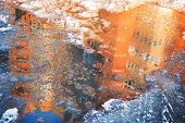 Reflection Of A House In An Ice Puddle In Spring. Melting Snow. poster