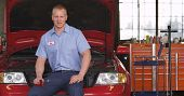 stock photo of auto repair shop  - Portrait of auto shop mechanic - JPG
