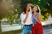 Two Young Female Friends Having Fun And Eating Ice Cream. Cheerful Caucasian Women Eating Icecream O poster