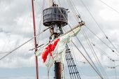 Tackles Of An Old Sailing Vessel - A Mast, A Mast, Raised Red-white Sails, Ropes. poster