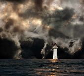 stock photo of lighthouse  - White lighthouse with dramatic storm clouds approaching - JPG
