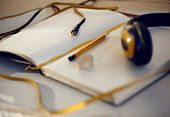 Bright Still Life From An Open Notebook With Yellow Bookmark, Yellow Pencil And Yellow Headphones poster