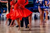 Woman Dancer In Red Dress Dancing On Background Other Dancers poster