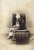 stock photo of tyne  - Portrait of Victorian young boy on chair - JPG