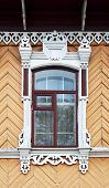 stock photo of uglich  - Window with decorated architraves of old wooden house - JPG