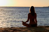 Woman In Yoga Lotus Meditation Front To Seaside