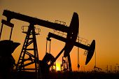 image of oil rig  - Silhouette of oil well with sunrise - JPG