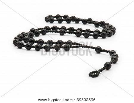 Black Rosary isolated on a white background