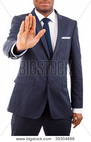 Afroamerican businessman in suit showing STOP, isolated on white