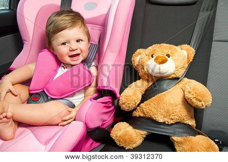baby in a safety car seat. Safety and security