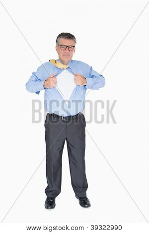 Businessman with glasses is pulling his shirt with his hands like a superhero